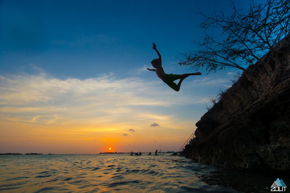 sunset jump ocean aruba